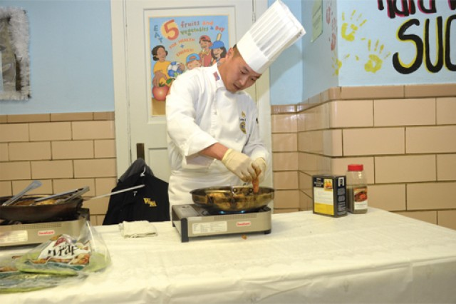 Sgt. Steve Behr, an instructor of the Advanced Culinary Skills Course at the Joint Culinary Center of Excellence, cooks chicken breasts marinated with chili powder and lemon juice for a Fuel Up to Play 60 event at Chesterfield County's Matoaca Elembentary School, Jan. 25.The chicken was part of a low-fat, fast wrap with several of the recommended food groups. (Photo by Kimberly K. Fritz)