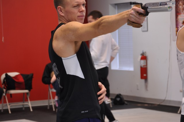 Spc. Dennis Bowsher, World Class Athlete Program, practices for the run-shoot portion of the Modern Day Pentathlon. Bowsher, who was ranked second in the nation in 2011, has already qualified for the 2012 Olympics in London.