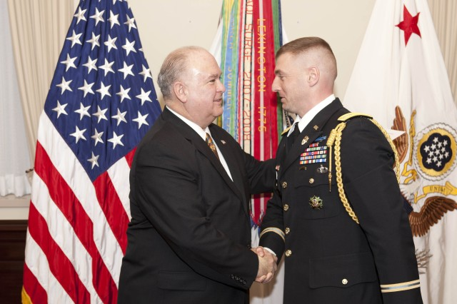 Under SecArmy promotes aide-de-camp to Lt. Col.