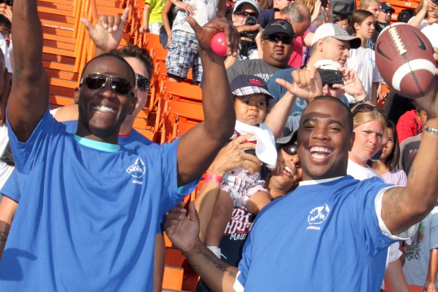 Soldiers with 84th Engineer Battalion, 130th Eng. Brigade, 8th Theater Sustainment Command, cheer on their favorite AFC and NFC players during Ohana Day at Aloha Stadium, Saturday.