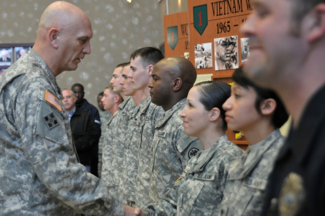 Army Chief of Staff Gen. Raymond T. Odierno presents a coin to Spc. Giselle Torres during a visit to 1st Infantry Division headquarters Feb. 3, 2012. Torres was one of eight Fort Riley community members recognized by the Chief of Staff for excellence. Also receiving a coin were Spc. Alex Link, Staff Sgt. Terence Mitchell, Spc. Margaret Justice, Sgt. Trevor Tong, Sgt. Luther Snow, Spc. Matthew Cardin, and Fort Riley Police Officer Patrick Felice