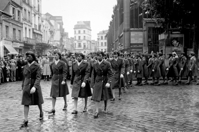 Members of the 6888th Central Postal Directory Battalion take part in a parade ceremony May 27, 1945, in honor of Joan d'Arc at the marketplace where she was burned at the stake. The battalion was made up of 855 enlisted black women and were a great help in World War II moving a year's worth of mail in three months.