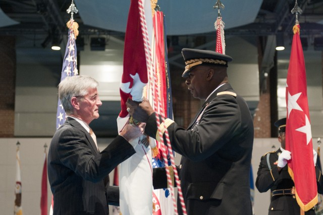 Secretary of the Army John McHugh passes the vice chief of staff of the Army flag to Gen. Lloyd J. Austin III during Austin's swearing-in ceremony at Joint Base Myer-Henderson Hall, Jan. 31, 2012.