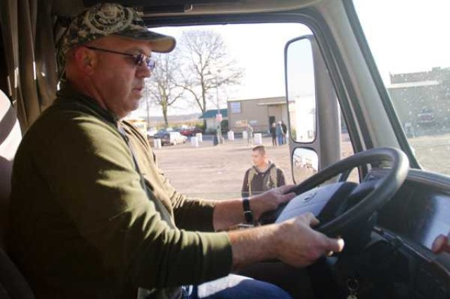 LAKEWOOD, Wash. (Jan. 26, 2012) Spc. James Moore puts the final touches on his semi before ending his school day at CDS in Lakewood, Jan. 26. CDS has partnered with 593rd Sust. Bde. for transporters studying as part of Sustainer University.