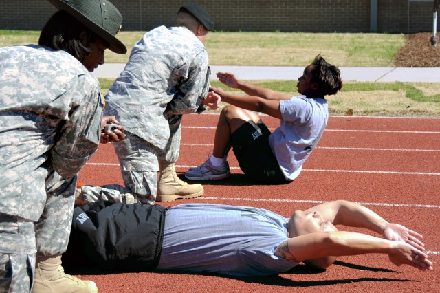 Soldiers at the Army's Physical Fitness School perform the third event in the new Army Physical Readiness Test, the one-minute rower, during a demonstration last August at Fort Jackson, S.C. The Army is now asking Soldiers to complete a survey to consider changes to the PT uniform.