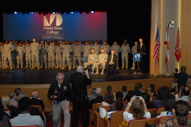 Florida Governor Rick Scott addresses the 841st Engineer Battalion's headquarters and forward support companies' departure ceremony at Miami Dade College, Feb. 4, 2012. Both companies will deploy to Afghanistan as part of Task Force Hurricane to provide command and control of combat and construction missions. The task force will also collaborate with the Afghan National Army in Regional Command North to improve security, development, and governance of the Government of the Islamic Republic of Afghanistan. (Photo by Sgt. 1st Class Phillip Eugene, 412th TEC Public Affairs)