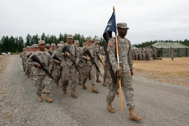Cadet David Houston, University of Maryland - College Park, carries the guidon for his platoon, made up of other Cadets from around the country, last summer at Joint Base Lewis-McChord, Wash. Houston's school has one of the eight top ROTC programs in the nation.