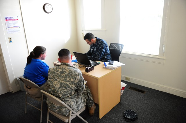 PRESIDIO OF MONTEREY, Calif. - A unit tax advisor helps a Soldier and his wife with their taxes at the Presidio of Monterey Tax Center Jan. 30.