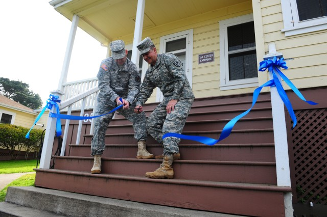PRESIDIO OF MONTEREY, Calif. - Presidio of Monterey Garrison Commander Col. Joel J. Clark (left) and Defense Language Institute Foreign Language Center Commandant Col. Danial D. Pick cut a ribbon to officially make the opening of the Presidio of Monterey Tax Center Jan. 30.