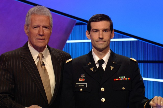 Capt. Brendan Graham, seen here with 'Jeopardy' host Alex Trebek, is donating half of his $47,602 winning to military charities.