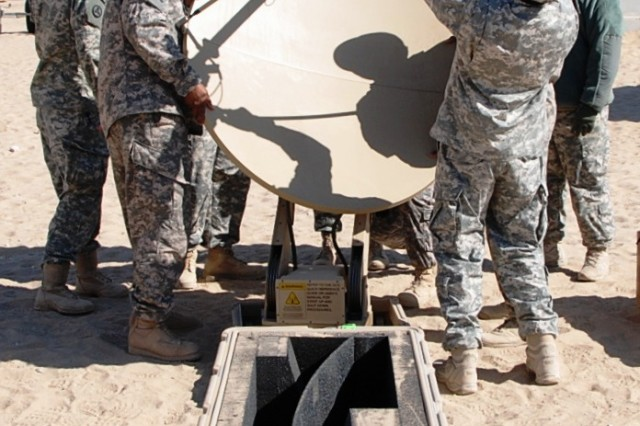 Soldiers from 233rd Transportation Company, 113th Sustainment Brigade, practice setting up VSAT communications during Redistribution Property Assistance Team Academy training Jan. 24, 2012, at Camp Virginia, Kuwait.
