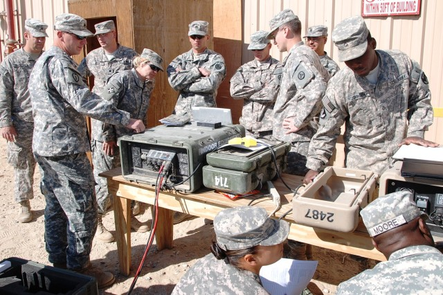 Pfc. Marcus Johnson (right), 541st Combat Sustainment Support Battalion support operations, works with Soldiers from 233rd Transportation Company, 113th Sustainment Brigade, to set up communications during Redistribution Property Assistance Team Academy training Jan. 24, 2012, at Camp Virginia, Kuwait.