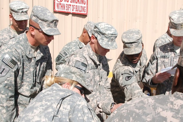 Pfc. Marcus Johnson (center right), 541st Combat Sustainment Support Battalion support operations, instructs a group of Soldiers from 233rd Transportation Company, 113th Sustainment Brigade, in setting up VSAT communications during Redistribution Property Assistance Team Academy training Jan. 24, 2012, at Camp Virginia, Kuwait.