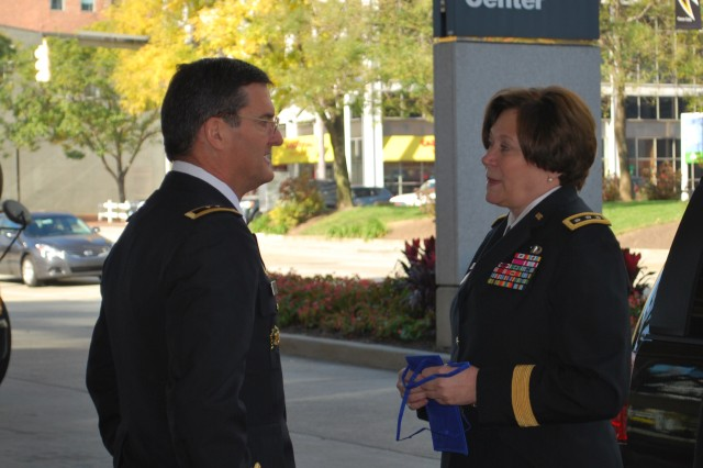 Maj. Gen. Randolph P. Strong, commander of the U.S. Army Communications-Electronics Command, welcomes Lt. Gen. Susan S. Lawrence, Army Chief Information Officer/G6, to the 2011 Military Communications Conference, or MILCOM, Nov. 7 at the Baltimore Convention Center.