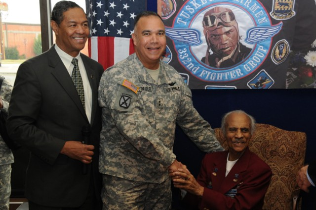 Retired Air Force Col. R. J. Lewis, president of the Tuskegee Chapter of Tuskegee Airman, Inc., Maj. Gen. Anthony G. Crutchfield, USAACE and Fort Rucker commanding general, with retired Lt. Col. Herbert E. Carter of the 99th Fighter Squadron, Tuskegee Airmen at Fort Rucker's Black History kickoff event at the PX Feb. 3.