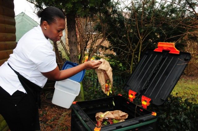 Raw foodist Saunya Odwyer recycles all of her raw food ingredients into a compost pile located in her backyard. The compost is used to help fertilize her garden throughout the year.