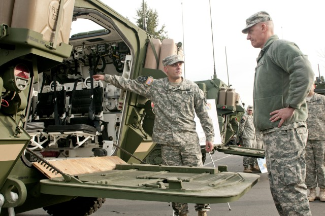 Gen. David Rodriquez, commander U.S. Army Forces Command, pays close attention as Staff Sgt. Jonathan Laguzza, 2nd Stryker Brigade Combat Team, 2nd Infantry Division, points out all the key safety features and details of his Stryker during his recent visit to Joint Base Lewis-McChord.