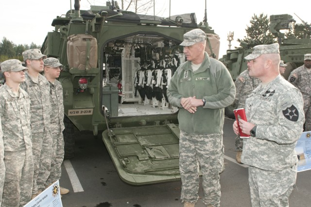 Gen. David Rodriquez, commander U.S. Army Forces Command, speaks with a Stryker vehicle crew from the 4th Stryker Brigade Combat Team, 2nd Infantry Division during a recent visit to Joint Base Lewis-McChord.  The Stryker Brigade Combat Teams worked in cooperation to provide a static display of Stryker variants for the FORSCOM commander to see up close and to meet the Soldiers who operate work with them.