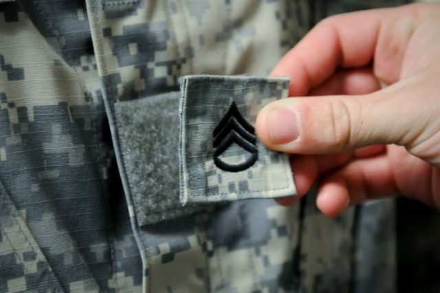 A U.S. Army Soldier has staff sergeant rank placed on his chest. (U.S. Army photo by Sgt. Edward A. Garibay, 16th Mobile Public Affairs Detachment)