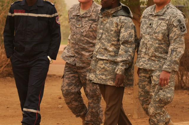 Maj. Dean A. Nelson (center left), with the 328th Combat Support Hospital, 807th Medical Deployment Support Command, and Lt. Col. David H. Moikeha (right) with the 94th CSH, 807th MDSC, tour an emergency response station with a Malian first responder and Malian interpreter as part of the Atlas Accord 12 exercise in Mopti, Mali, Feb. 6, 2012.