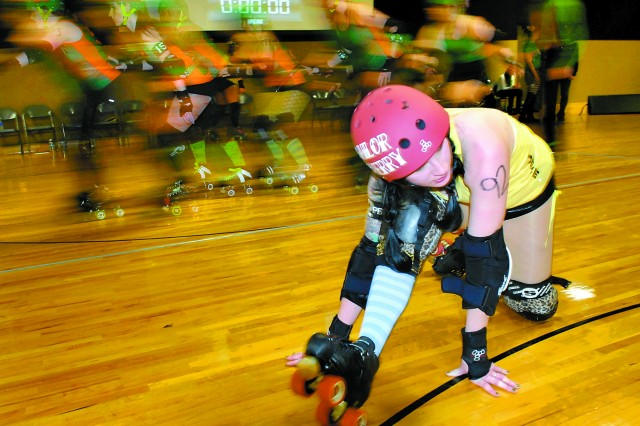 Bettie Brigaders exhort the crowd as skaters are introduced during the team's season opening bout with Femme Fianna Feb. 4 at AFC Arena on JBLM Lewis Main. Bettie Brigade won the bout 148-74.