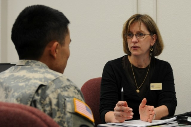 "JOINT BASE LEWIS-McCHORD, Wash. ""-Lori Mann, right, an Army Career and Alumni Program counselor offers career guidance to a Soldier at the ACAP center at Joint Base Lewis-McChord, Wash., on Feb. 2. (U.S. Army photo by Sgt. Ashley M. Outler)"