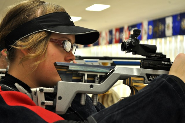 Tessa Howald, competing in the precision division for Ozark High School, reloads her rifle at the 2012 Army JROTC Air Rifle Championships.