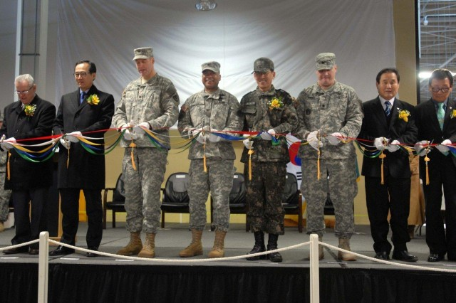 Key leaders from 19th Expeditionary Sustainment Command and the Korean Service Corps cut the grand-opening ribbon for the opening of the KSC Humidity Control Warehouse at Camp Carroll Feb. 10.  The warehouse, the largest in the U.S. Army, is dedicated to past and current KSC workers who have supported the U.S.-Republic of Korea alliance.