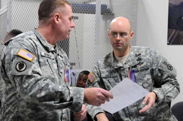 Col. Lee Merritt, the 3d Sustainment Command (Expeditionary)'s chief of staff, discusses a memo with Chief Warrant Officer 3 Joseph Giles, the 3d ESC's aerial delivery technician and safety officer, Jan. 24, 2012, during the 3d ESC's Unified Endeavor exercise. The exercise is one of several conducted before the unit deploys to Afghanistan later this year.