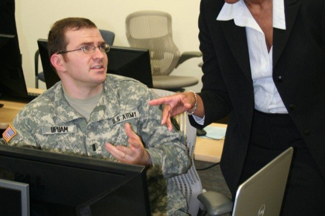 1LT Bryan Upham, Ft. Belvoir Warrior Transition Unit, discusses tips on preparing a federal resume and seeking U.S. government jobs from Deshan Mingo, Senior Federal Recruitment Advisor, Office of Personnel Management. Mingo, an Army veteran, provided instruction to 30 wounded, ill and injured servicemembers from the National Capitol Region at a resume writing workshop hosted by the Ft. Belvoir Community Hospital, Ft. Belvoir, Va.