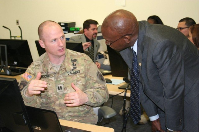 CPT Jason Moore, Ft. Belvoir Warrior Transition Unit, receives feedback from Alan Thompson, Veterans Representative, Office of Personnel Management at the Warrior Transition Command's Federal Resume Writing Workshop hosted at Ft. Belvoir Community Hospital, Ft. Belvoir, Va. Moore was one of 30 wounded, ill and injured Servicemembers that benefited from the two-day workshop that focused on the finer points of preparing a federal resume.
