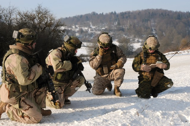U.S. Marines (right) from the 2nd Air Navel Gunfire Liaison Company, Camp Lejeune, North Carolina, call for close air support with soldiers in the Georgian army 23rd Light Infantry Battalion during a training exercise at the Joint Multinational Readiness Center, Hohenfels, Germany, Feb. 8, 2012. The JMRC, working with U.S Marine Forces Europe as part of the Georgia Deployment Program-International Security Assistance Force, conducts mission rehearsal exercises for Georgian infantry battalions to assist them in preparing to deploy for operations in Afghanistan.  (U.S. Army photo by Spc. W. Ryan Livingston/Released)