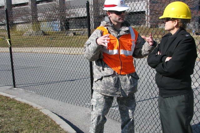 Col. Beverly Land, Keller Army Community Hospital commander and Maj. Christopher Kiss, U.S. Army Health Facility Planning project officer, discuss the way ahead for phase one of the Keller Army Community Hospital Clinic Addition construction project.