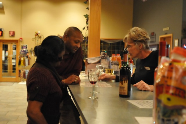 Sgt. Maj. Duane Strong and wife, Teri, sample wines during the Feb. 10 Family Readiness Group event at Lavender Crest Winery in Colona, Ill.
