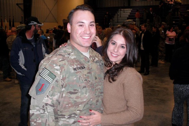 Sgt. Anthony Petrola pauses for a picture with his wife Megan following his return from Afghanistan Dec. 18, 2011. First Infantry Division Facebook fans recently voted the Petrolas the winners of the Best BRO Love Story Contest.