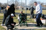 Coach sets chair for shot put