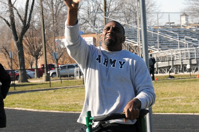 Sgt. Charles Allen, who was medically retired from Fort Hood, Texas, puts the shot for the first time during a Warrior Games preparation camp at Fort Belvoir, Va. This is his first year doing the shot put, discus and basketball.