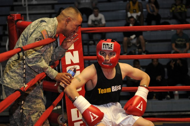 "Sgt. Jaime Munoz, 29th Engineer Company, 1st Battalion, 35th Infantry Regiment, gets some advice from his corner during the Fort Bliss and El Paso Golden Gloves ""Border Rumble"" Feb. 10, 2012 at Mitchell W. Stout Gym."