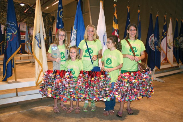 Thorin Jean (first from left) and fellow Girl Scout Troop 066 members prepare to distribute 850 paper lei Thorin made to redeploying 25th ID Soldiers, recently.