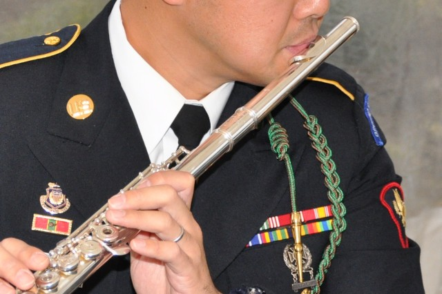 FORT BRAGG, N.C. (Feb. 13, 2012)  Flautist Spc. Zhao Liu is just one of the highly talented Soldiers in The Army Ground Forces Band. He studied flute at the New England Conservatory of Music and Yale University.