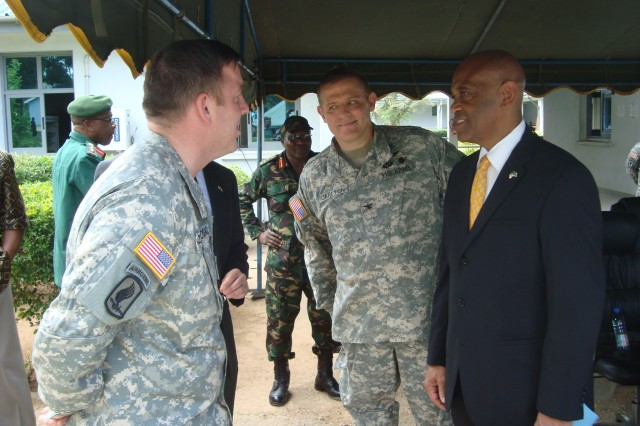 Capt. Kevin Czarkowski (left), the team chief for the 772nd Civil Support Team, 7th Civil Support Command, Col. Darrel K. Carlton (center), a U.S. Army ophthalmologist and officer-in-charge of the Tanzanian Medical Readiness and Training Exercise, and the U.S. Ambassador to the United Republic of Tanzania, Alfonso E. Lenhardt, discuss the MEDRETE held in Zanzibar, Tanzania. from Jan. 30 to Feb. 12, 2012. Tanzanian and U.S. Army medical providers worked together to not only improve working relationships, but also provide medical services to citizens in need of treatment. Local citizens traveled to the Zanzibar Military Hospital in Bububu to obtain free cataracts surgery.