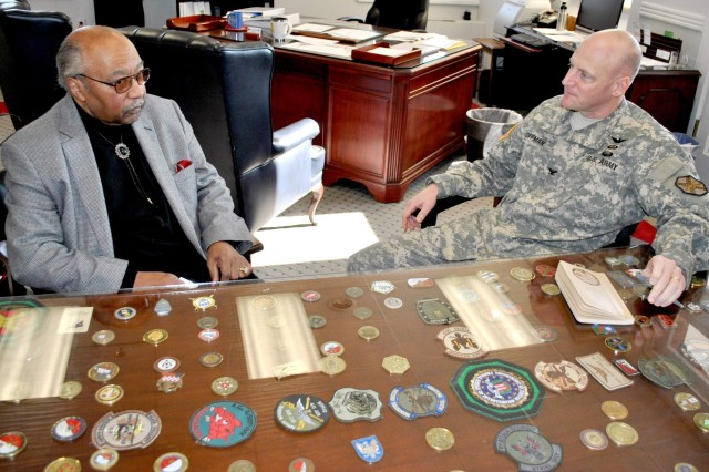 Former Fort Myer post commander and retired Maj. Gen. Harvey D. Williams chats with current Joint Base Myer-Henderson Hall Commander Col. Carl R. Coffman this past January inside the Joint Base Myer-Henderson Hall headquarters. Williams is the first African-American to be installed as the Fort Myer, Va., (now Joint Base Myer-Henderson Hall) commander.