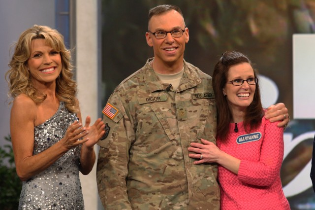 Maj. Andrew Rigor, Executive Officer 368th Engineer Battalion, with his wife Maryanne on the Wheel of Fortune set with Vanna White Jan. 12, 2012. Rigor returned from Afghanistan and surprised his wife who was a contestant during the taping of an episode dedicated to military spouses.