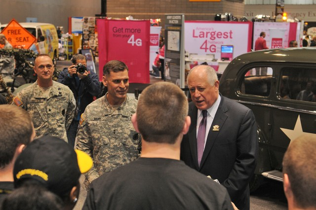 After the opening ceremony, Illinois Gov. Pat Quinn visited the U.S. Army exhibit, and briefly met with Soldiers, the Commanding General of U.S. Army Recruiting Command, Maj. Gen. David L. Mann, in front of Gen. George S. Patton's 1938 Cadillac staff car, on loan for the first time from the Patton Museum at Fort Knox, Ky.