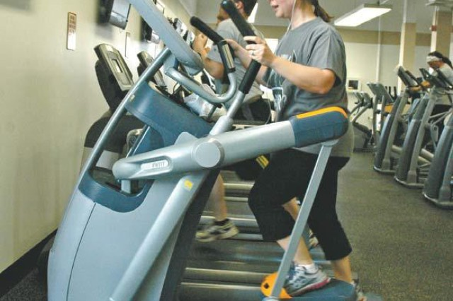 APG employee Bengu Isguder uses a new Precor Adaptive Motion Trainer during the open house Feb. 6.