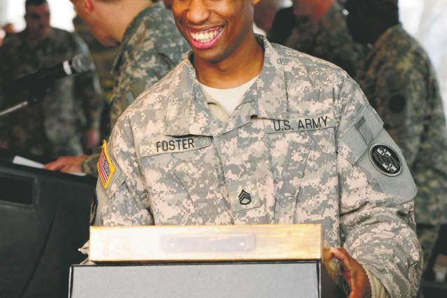 Staff Sgt. Bijyon Foster Maryland National Guards' Aviation Depot Maintenance Roundout Unit (ADMRU) is all smiles after receiving his Freedom Salute kit commemorating his service in the Global War on Terror during the unit's official welcome home ceremony at Top of the Bay at Feb. 4.