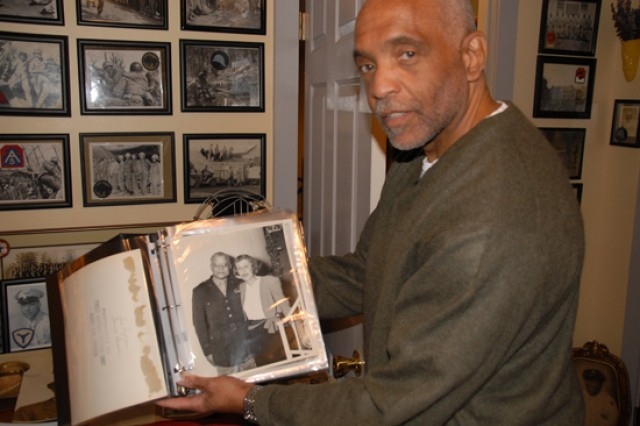 George Hardy displays a photo of Gen. Benjamin O. Davis from a binder of photographs. The majority of Hardy's collection comprises anonymous pictures found on the Internet or in flea markets, as well as donations from family and friends.