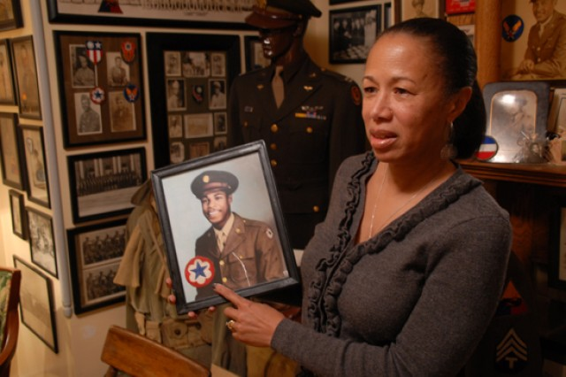 Rochelle Hardy holds a picture of her uncle, Stanley Sargent, in uniform -- his unit patch accompanies the picture. Rochelle's husband, George, maintains a substantial collection of African-American World War II-era memorabilia at his Maryland home, and occasionally loans out parts of the collection for use in public exhibits.
