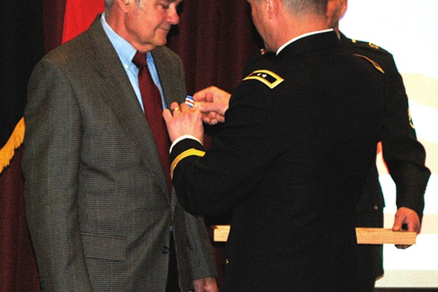 U.S. Army Alaska Commander Maj. Gen. Raymond P. Palumbo awards the Silver Star to Vietnam veteran Dr. Paul Taylor of Fairbanks, Alaska, in a Feb. 4, 2012, ceremony on Fort Wainwright.