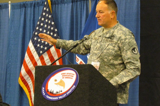 The Aviation and Missile Command's Maj. Gen. Jim Rogers speaks about the need for efficiencies during the Joseph P. Cribbins Aviation Product Symposium on Feb. 8.